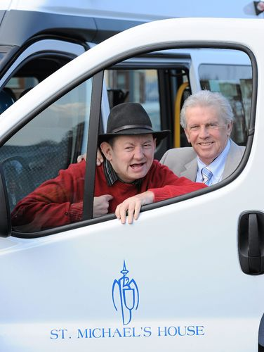 Johnny Giles presents Soccerex Bus to Sallowood Unit